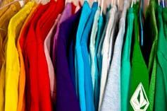 Close-up of shirts of different colors hanging in a closet