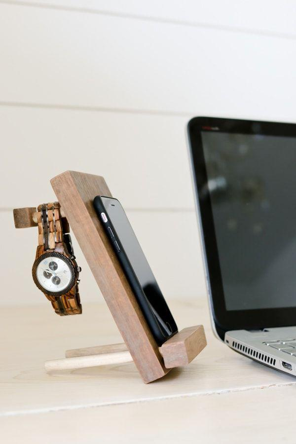 """<p>A simple wood craft yields a sophisticated multi-purpose stand for his cell phone, watch, glasses, and more. </p><p><a href=""""https://www.tidbits-cami.com/diy-cell-phone-stand-and-accessory-holder/"""" rel=""""nofollow noopener"""" target=""""_blank"""" data-ylk=""""slk:Get the tutorial."""" class=""""link rapid-noclick-resp"""">Get the tutorial. </a></p><p><a class=""""link rapid-noclick-resp"""" href=""""https://www.amazon.com/Gorilla-18-Ultimate-Waterproof-Natural/dp/B08J1MJ28D?tag=syn-yahoo-20&ascsubtag=%5Bartid%7C10072.g.27603456%5Bsrc%7Cyahoo-us"""" rel=""""nofollow noopener"""" target=""""_blank"""" data-ylk=""""slk:SHOP WOOD GLUE"""">SHOP WOOD GLUE</a></p>"""