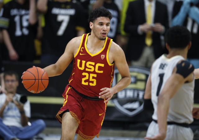 Southern California forward Bennie Boatwright, left, picks up a loose ball as Colorado guard Tyler Bey drops back to defend in the first half of an NCAA college basketball game Saturday, March 9, 2019, in Boulder, Colo. (AP Photo/David Zalubowski)