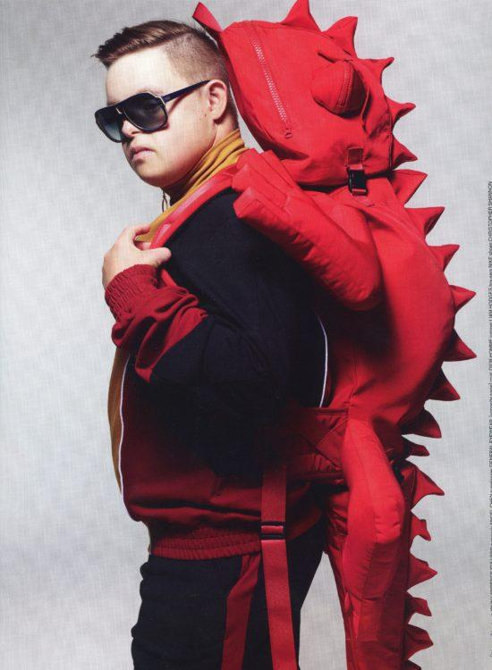 Jack Brumpton wearing a red iguana backpack for a magazine