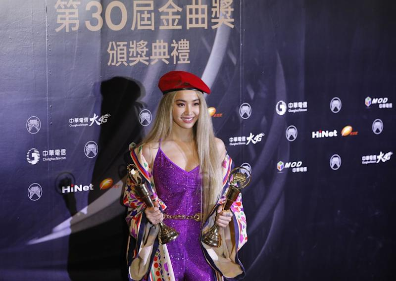 Taiwanese singer Jolin Tsai poses with her trophies after winning the Song of the year and Album of the year at the 30th Golden Melody Awards in the Taipei on June 29, 2019. (Photo by Daniel Shih/Getty Images/AFP)