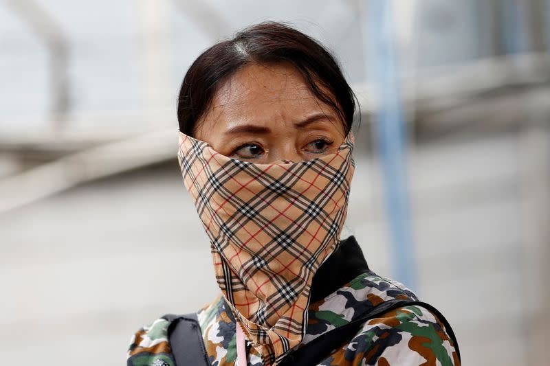 A woman wears a handkerchief at station Tanah Abang, following the outbreak of the coronavirus in China, in Jakarta