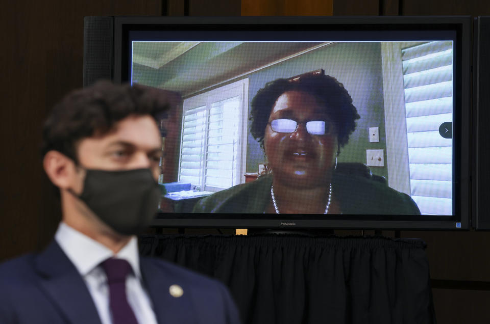 Stacey Abrams testifies remotely via video conference as Sen. Jon Ossoff, D-Ga., listens during a Senate Judiciary Committee hearing on voting rights on Capitol Hill in Washington, Tuesday, April 20, 2021. (Evelyn Hockstein/Pool via AP)