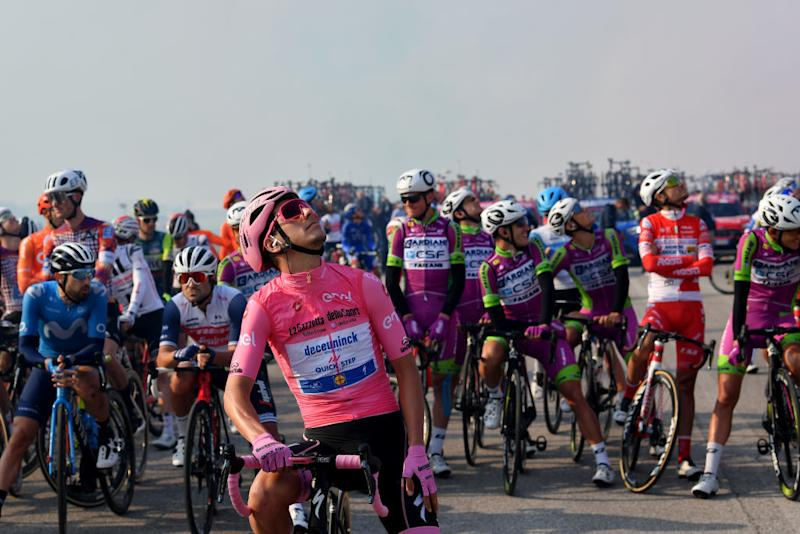 PIANCAVALLO ITALY OCTOBER 18 Start Joao Almeida of Portugal and Team Deceuninck QuickStep Pink Leader Jersey Frecce Tricolori Air Patrol Aerial exhibition Base Aerea Rivolto Team Presentation Peloton during the 103rd Giro dItalia 2020 Stage 15 a 185km stage from Base Aerea Rivolto Frecce Tricolori to Piancavallo 1290m girodiitalia Giro on October 18 2020 in Piancavallo Italy Photo by Stuart FranklinGetty Images