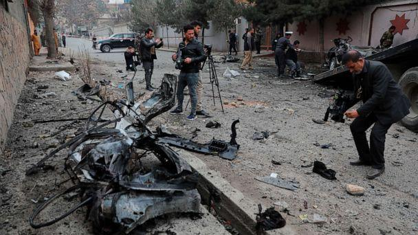 PHOTO: Afghan journalists film at the site of a bombing attack in Kabul, Afghanistan, Feb. 20, 2021. (Rahmat Gul/AP)