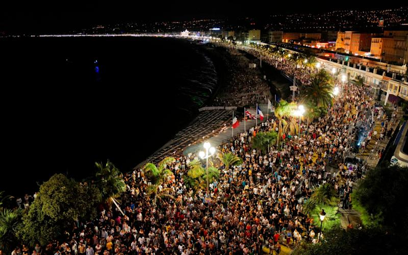 People gather on the Baie des Anges to hear the set of French DJ and producer The Avener during a concert, the first public show in Nice since the shutdown - YANN COATSALIOU/AFP via Getty Images