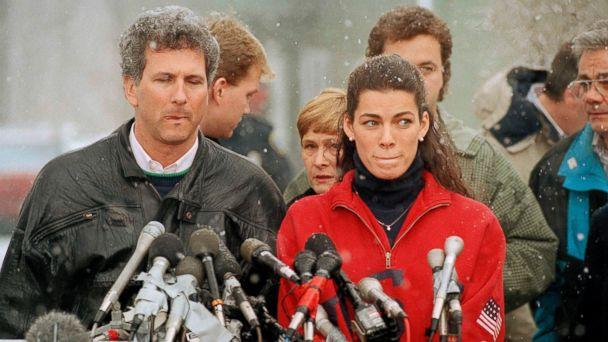 PHOTO: Olympic figure skater Nancy Kerrigan stands at a news conference in Boston, Jan. 14, 1994, as her agent Jerry Solomon, left, looks on. (Steven Senne/AP Photo)