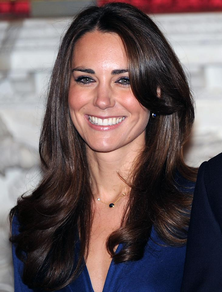 "<p>Kate's look is all about having the hair in the best condition possible. Start with a <a rel=""nofollow"" href=""https://click.linksynergy.com/fs-bin/click?id=93xLBvPhAeE&subid=0&offerid=390098.1&type=10&tmpid=8157&RD_PARM1=http%253A%252F%252Fshop.nordstrom.com%252Fs%252Fserge-normant-dream-big-instant-volumizing-spray%252F3856513%253Forigin%253Dkeywordsearch-personalizedsort&u1=POROYALSKateBlowoutMM"">volumizing spray</a>. Apply it in small sections to achieve optimal root lift.</p>"