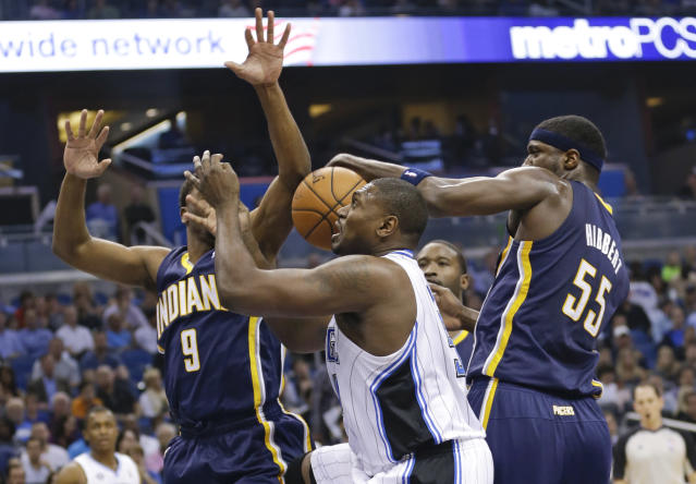 Indiana Pacers' Solomon Hill (9) and Roy Hibbert (55) go after a rebound against Orlando Magic's Jason Maxiell, center, during the first half of an NBA basketball game in Orlando, Fla., Wednesday, April 16, 2014. (AP Photo/John Raoux)