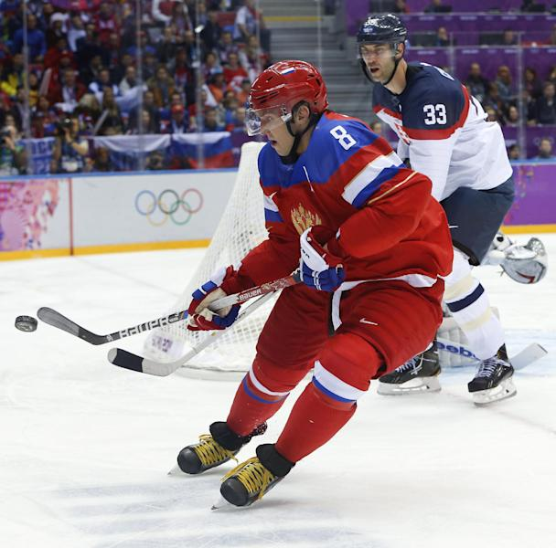 Russia forward Alexander Ovechkin brings the puck around the back of the goal against Slovakia in the first period of a men's ice hockey game at the 2014 Winter Olympics, Sunday, Feb. 16, 2014, in Sochi, Russia. (AP Photo/Mark Humphrey)