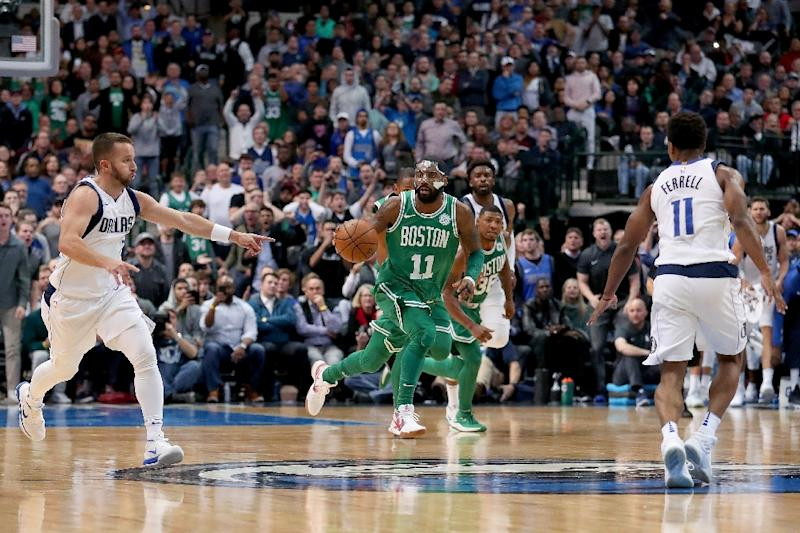 Kyrie Irving (C) of the Boston Celtics was in dazzling form as Boston rallied from a 10-point deficit to overhaul the Dallas Mavericks 110-102 in overtime (AFP Photo/TOM PENNINGTON)