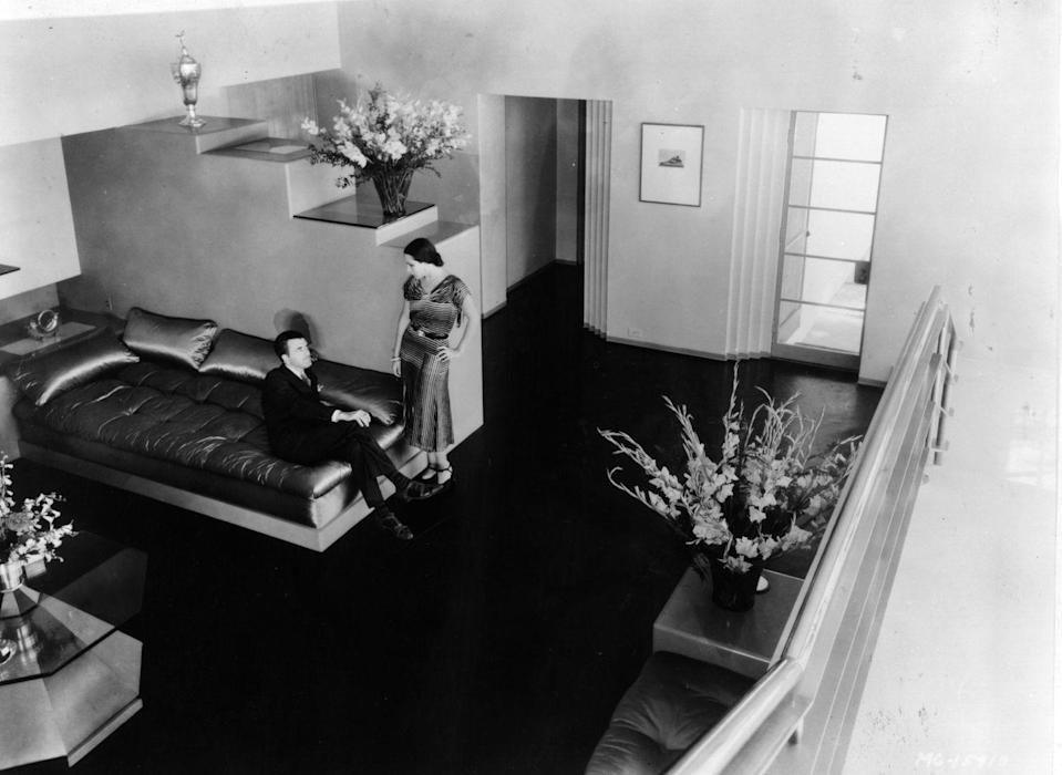 """<p>Mexican actress Dolores Del Río and her husband, MGM's in-house art director Cedric Gibbons, showcase their minimalist decor in their Los Angeles living room in 1935. Cedric, who is responsible for the Oscar trophy design, <a href=""""https://www.veranda.com/decorating-ideas/a1559/cedric-gibbons-house-tour/"""" rel=""""nofollow noopener"""" target=""""_blank"""" data-ylk=""""slk:built the famous art deco home for his wife"""" class=""""link rapid-noclick-resp"""">built the famous art deco home for his wife</a>.</p>"""