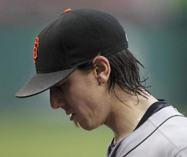 San Francisco Giants pitcher Tim Lincecum walks to the dugout after being removed from a baseball game against the Washington Nationals during the third inning, Saturday, Aug. 23, 2014, in Washington. The Nationals won 6-2. (AP Photo/Luis M. Alvarez)