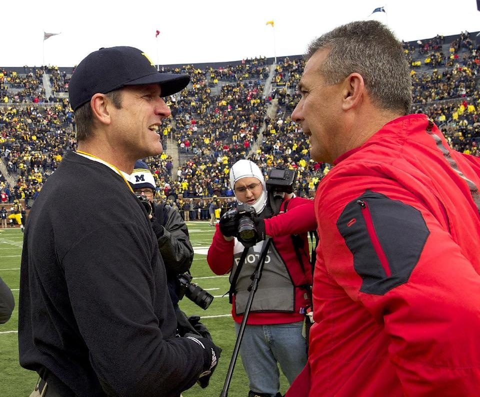 Will Jim Harbaugh have better luck against Urban Meyer and Ohio State the second time around? (AP)