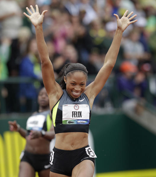 Allyson Felix celebrates her first place finish in the women's 200 meters at the U.S. Olympic Track and Field Trials Saturday, June 30, 2012, in Eugene, Ore. (AP Photo/Marcio Jose Sanchez)