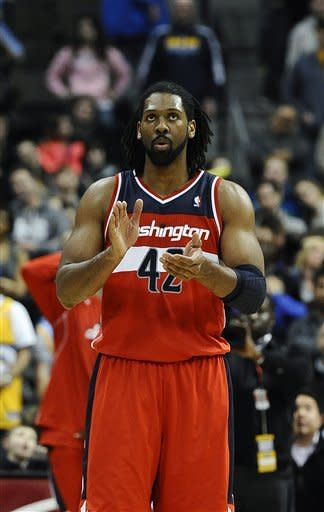 Washington Wizards center Nene, of Brazil, celebrates as they defeat the Denver Nuggets 112-108 in an NBA basketball game on Friday, Jan. 18, 2013, in Denver. (AP Photo/Chris Schneider)