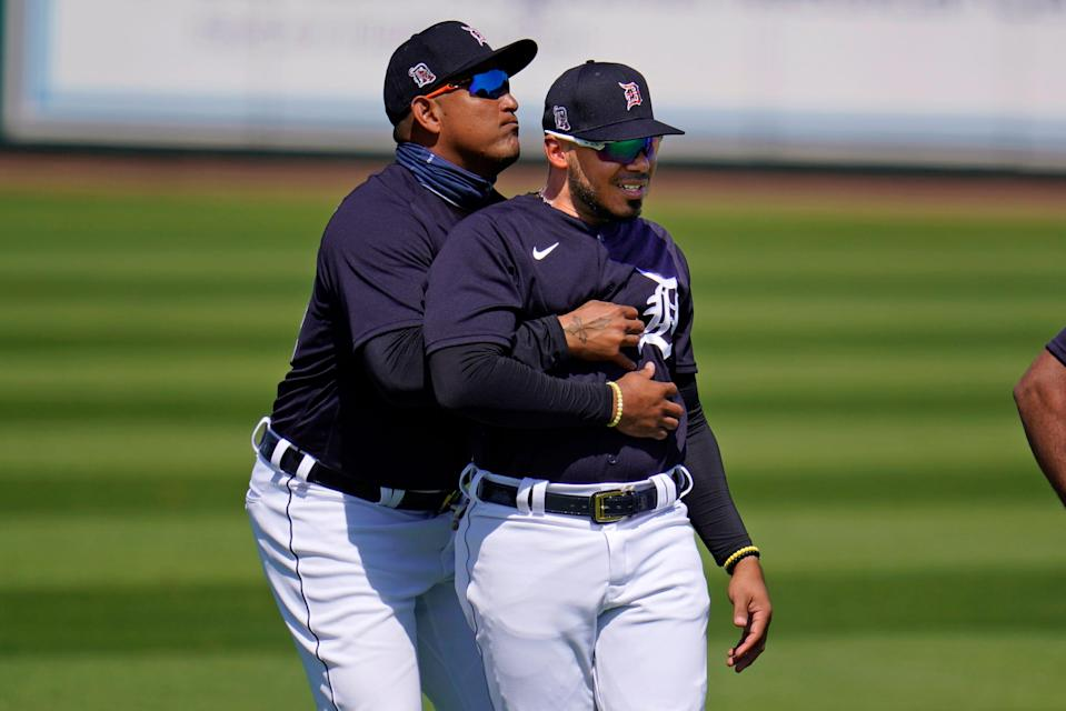 Detroit Tigers' Miguel Cabrera, left, plays around with Harold Castro while the two were warming up for a spring training exhibition baseball game against the Philadelphia Phillies at Publix Field at Joker Marchant Stadium, in Lakeland, Fla., Wednesday, March 3, 2021. (AP Photo/Gene J. Puskar)