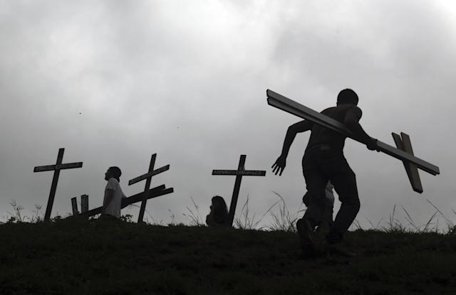 <p>People place crosses, representing people who have died during the most recent opposition protest movement, on the side of the highway during a national sit-in against President Nicolas Maduro, in Caracas, Venezuela, Monday, May 15, 2017. (AP Photo/Fernando Llano) </p>