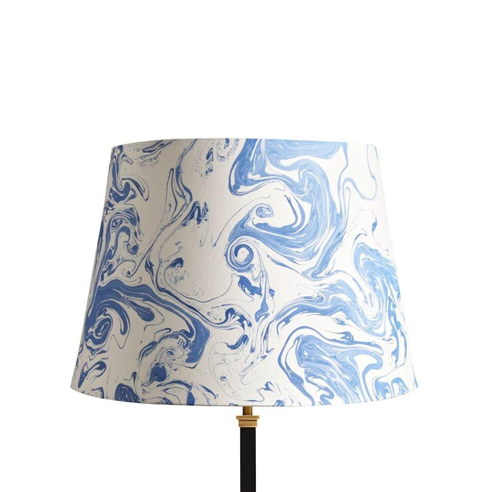"""<p>This mesmerising marble paper is made in Jaipur, using traditional marbling techniques that date back hundreds of years. A truly unique take, as no two lampshades are ever the same. <br></p><p><strong>Shop now: <a href=""""https://www.pooky.com/lampshades/40cm-straight-empire-hand-made-marble-paper-shade-in-tiber#selection.config_size=40&selection.shade_fabric_color=TIBBLW"""" rel=""""nofollow noopener"""" target=""""_blank"""" data-ylk=""""slk:Straight Empire Marble Paper Lampshade at Pooky"""" class=""""link rapid-noclick-resp"""">Straight Empire Marble Paper Lampshade at Pooky</a></strong></p>"""
