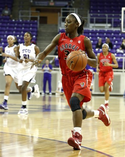 Georgia guard Erika Ford (31) moves the ball upcourt in the first half of an NCAA women's college basketball game against TCU, Wednesday, Dec. 19, 2012, in Fort Worth, Texas. (AP Photo/Sharon Ellman)