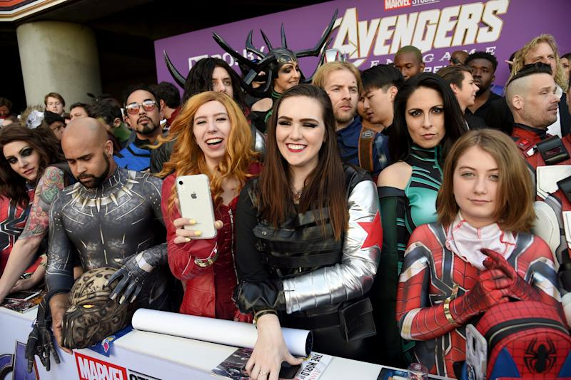 "Fans dressed as Marvel characters are seen during the premiere of ""Avengers: Endgame"" at the Los Angeles Convention Center on Monday, April 22, 2019. (Photo by Chris Pizzello/Invision/AP)"