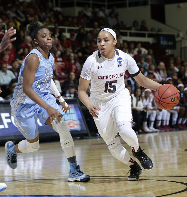 South Carolina guard Tiffany Davis (15) dribbles past North Carolina guard Diamond DeShields during the first half of a regional semifinal at the NCAA college basketball tournament in Stanford, Calif., Sunday, March 30, 2014. (AP Photo/Marcio Jose Sanchez)