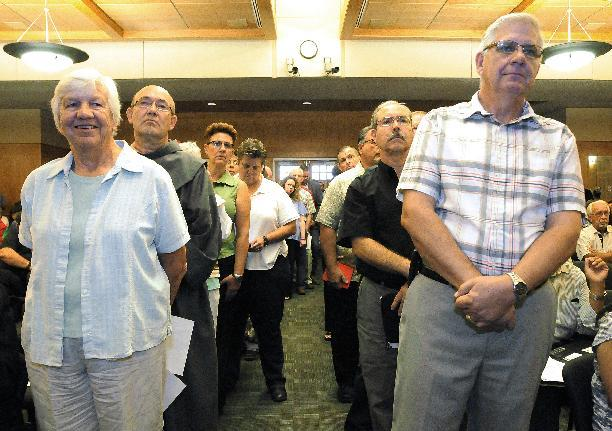 Members of the public wishing to comment on same-sex marriages are split into two lines on Tuesday, Aug. 27, 2013 during the Doña Ana County Commissioners meeting in Las Cruces, N.M. Spirited comments were given for over two hours as those in favor of same-sex marriage stand on the left and the opposed on the right. The meeting resulted with commissioners chose to pass a resolution, with a 4-1 vote, in support of the county issuing same-sex marriage licenses. (AP Photo/Las Cruces Sun-News, Robin Zielinski)