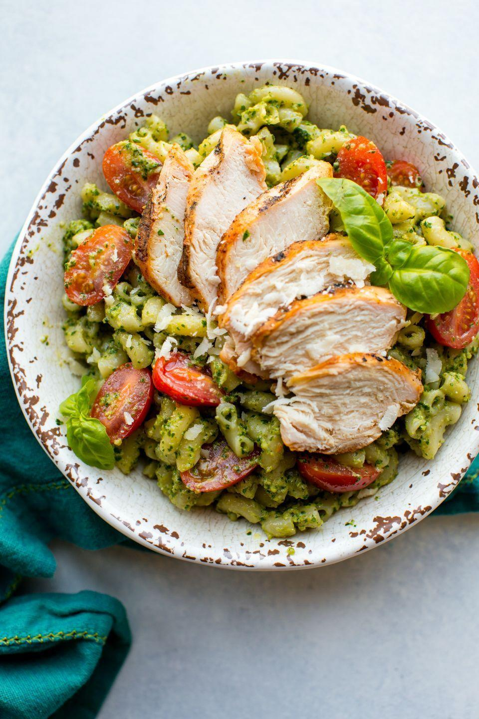 """<p>Ready in under 30 minutes, you'll flip for this simple homemade pesto. Using part kale and basil, it's a next level sauce your pasta deserves.</p><p>Get the recipe from <a href=""""https://www.delish.com/cooking/recipe-ideas/recipes/a52790/kale-pesto-chicken-pasta-recipe/"""" rel=""""nofollow noopener"""" target=""""_blank"""" data-ylk=""""slk:Delish"""" class=""""link rapid-noclick-resp"""">Delish</a>.</p>"""