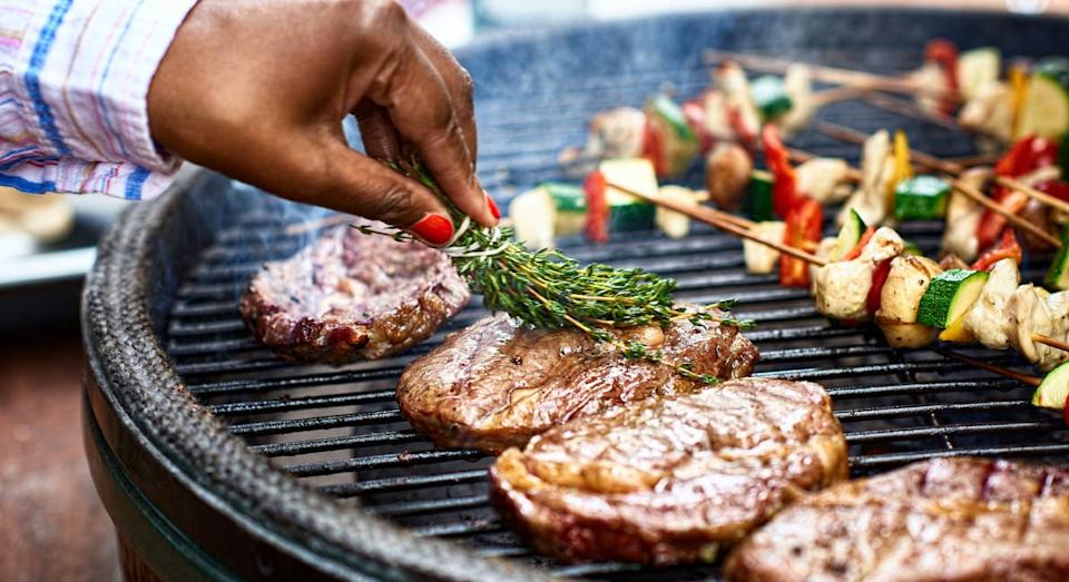 This brush makes cleaning a BBQ a lot easier. (Getty Images)