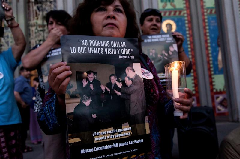 People protest against Juan Barros, current Bishop of Osorno, in front of a cathedral in Osorno, Chile, on Feb. 23, 2018. Abuse victims say Barros witnessed abuse by Chile's the Rev. Fernando Karadima, who was convicted in 2011.
