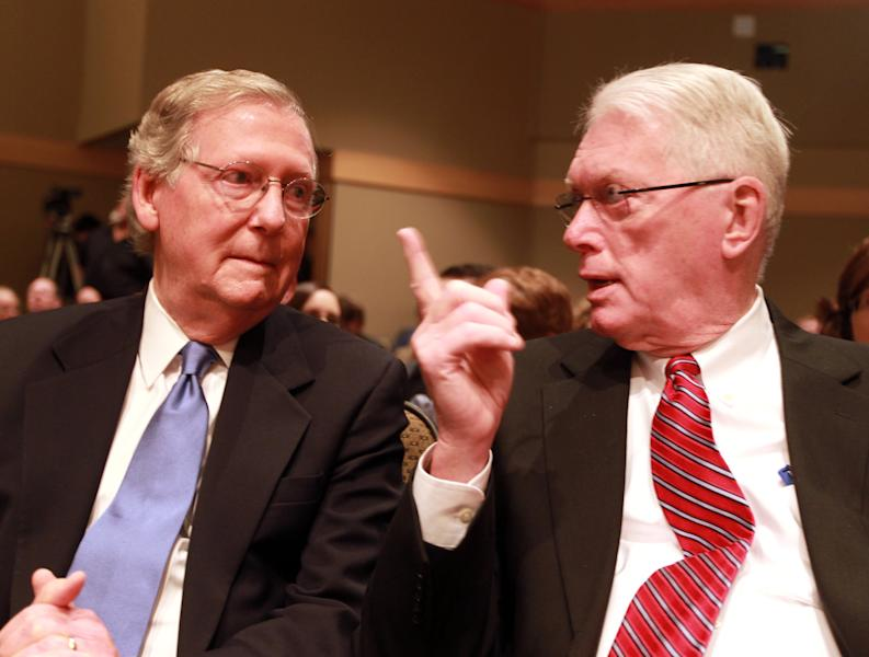 Former Sen. Jim Bunning, right, talks with U.S. Senate, Republican Leader Mitch McConnell, R-Ky., in a theater at Northern Kentucky University where McConnell gave a lecture on Bunning's career Friday, Sept. 6, 2013, in Highland Heights, Ky. Some three years after helping to push the baseball Hall-of-Famer out of the U.S. Senate, McConnell is singing Bunning's praises as a political leader who wasn't afraid to stand up for his beliefs in Washington, even when it meant standing alone. (AP Photo/The Cincinnati Enquirer, Patrick Reddy) MANDATORY CREDIT; NO SALES