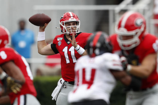 Georgia quarterback Jake Fromm (11) throw from the pocket against Arkansas State in the first half of an NCAA college football game Saturday, Sept. 14, 2019, in Athens, Ga. (AP Photo/John Bazemore)