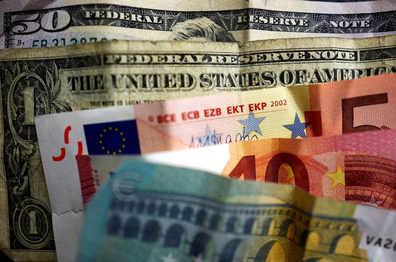 U.S. dollar and Euro bank notes are photographed in Frankfurt, Germany, in this illustration picture