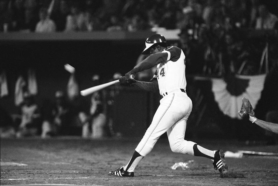 FILE - In this April 8, 1974, file photo Atlanta Braves' Hank Aaron hits his 715th career home run in Atlanta Stadium to break the all-time record set by the late Babe Ruth. Hank Aaron, who endured racist threats with stoic dignity during his pursuit of Babe Ruth but went on to break the career home run record in the pre-steroids era, died early Friday, Jan. 22, 2021. He was 86. The Atlanta Braves said Aaron died peacefully in his sleep. No cause of death was given. (AP Photo/Joe Holloway, Jr., File)
