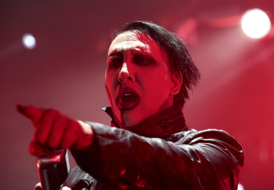 FILE - In this Aug. 2, 2015, file photo, Marilyn Manson performs in concert in Camden, N.J. Detectives are investigating Manson for allegations of domestic violence that reportedly occurred about a decade ago in West Hollywood, authorities said. The domestic violence is believed to have occurred between 2009 and 2011, when Manson lived in the city of West Hollywood. (Photo by Owen Sweeney/Invision/AP, File)