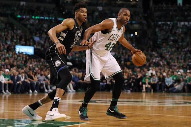 Giannis Antetokounmpo (L) of the Milwaukee Bucks defends Al Horford of the Boston Celtics on April 15, 2018 in Boston, Massachusetts (AFP Photo/Maddie Meyer)