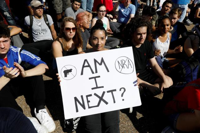 Students who walked out of their Montgomery County, Maryland, schools protest against gun violence in front of the White House. (Kevin Lamarque / Reuters)