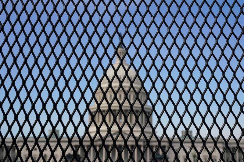 FILE PHOTO: The U.S. Capitol is seen through a security fence in Washington