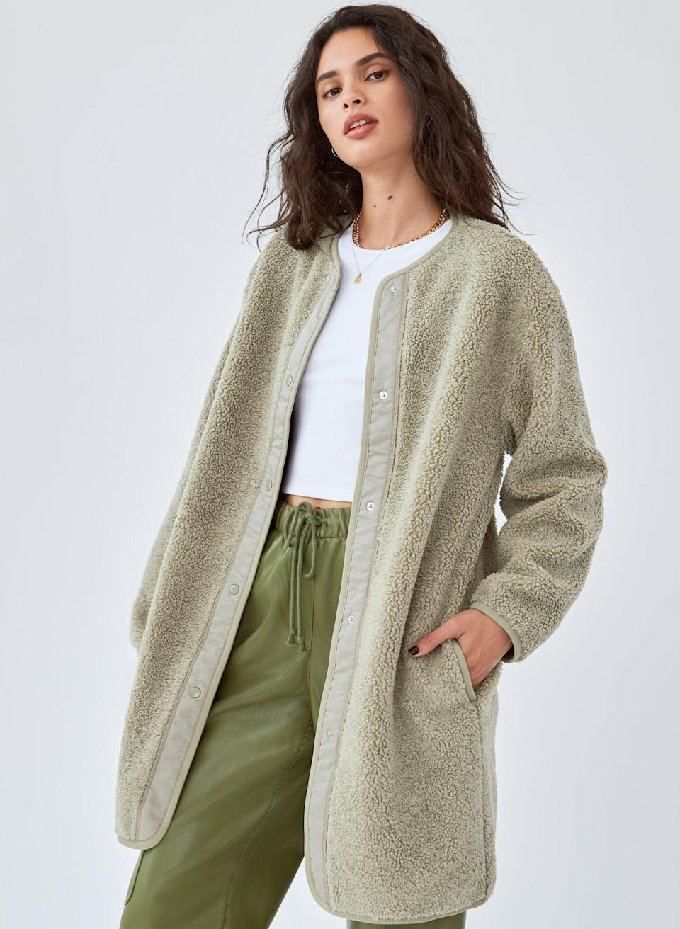 """Lean into the earthy autumnal vibes with this collarless jacket that's ideal for stay snug on days when it's just a tad windy. $98, Aritzia. <a href=""""https://www.aritzia.com/us/en/product/sherpa-long-liner-jacket/79514.html?dwvar_79514_color=16372"""" rel=""""nofollow noopener"""" target=""""_blank"""" data-ylk=""""slk:Get it now!"""" class=""""link rapid-noclick-resp"""">Get it now!</a>"""