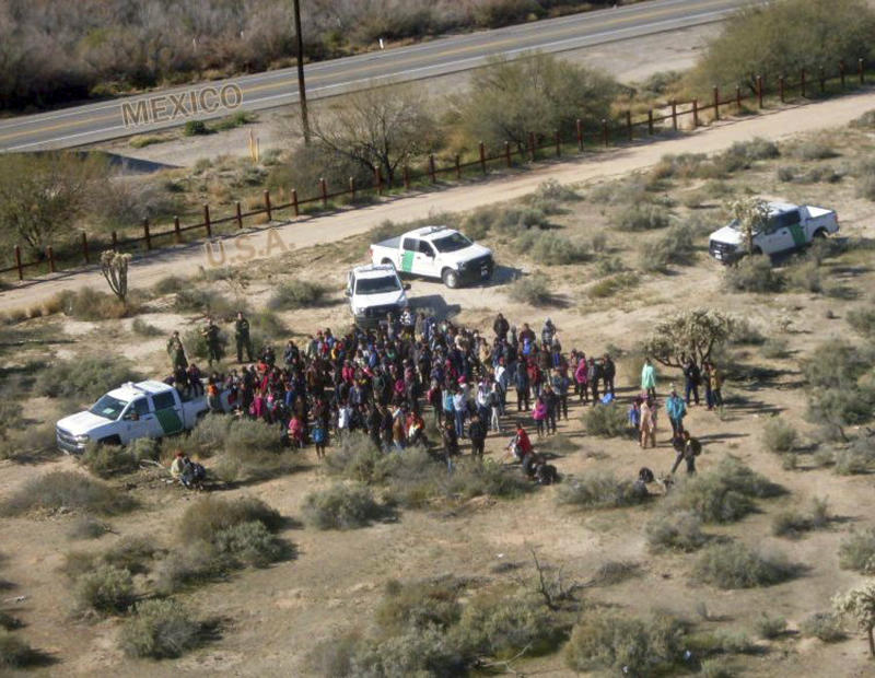 Migrants are apprehended after illegally crossing the U.S.-Mexico border
