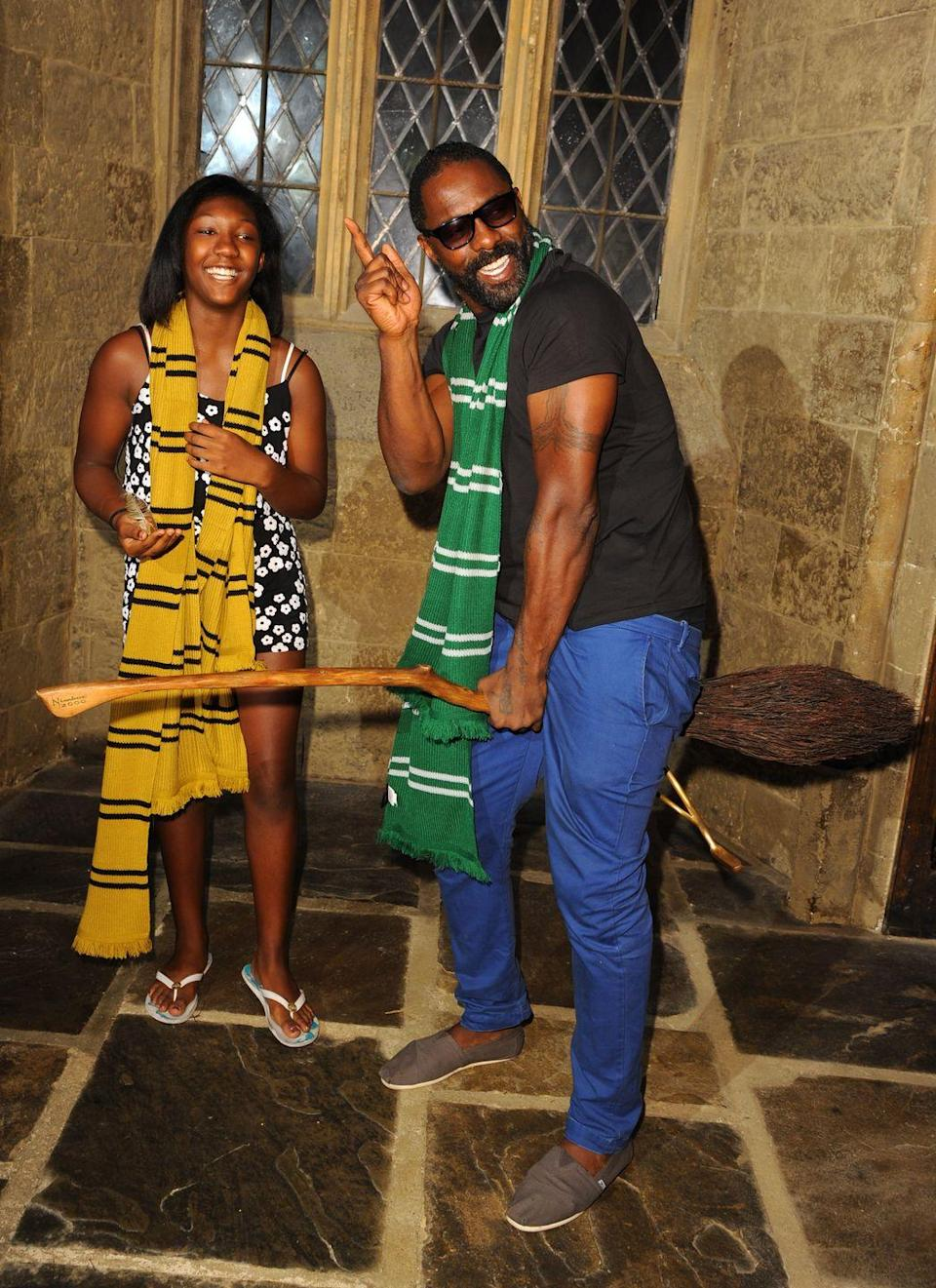 <p>Idris Elba goofs around with his daughter, Isan, at a VIP screening of <em>Harry Potter and the Philosopher's Stone </em>in Watford, England in 2014. </p>