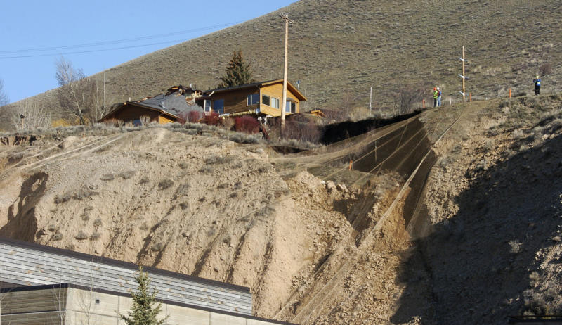 A slow-motion landslide is seen Saturday, April 19, 2014, on East Gros Ventre Butte in Jackson, Wyo. No one can say when the mountainside collapsing into this Wyoming resort town will give way. But it appears increasingly likely that when it does, it's going to take a piece of Jackson with it. (AP Photo/Matthew Brown)