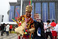 <p>Supporters didn't hold back in their efforts to be as colourful as possible in Russia. (Getty) </p>
