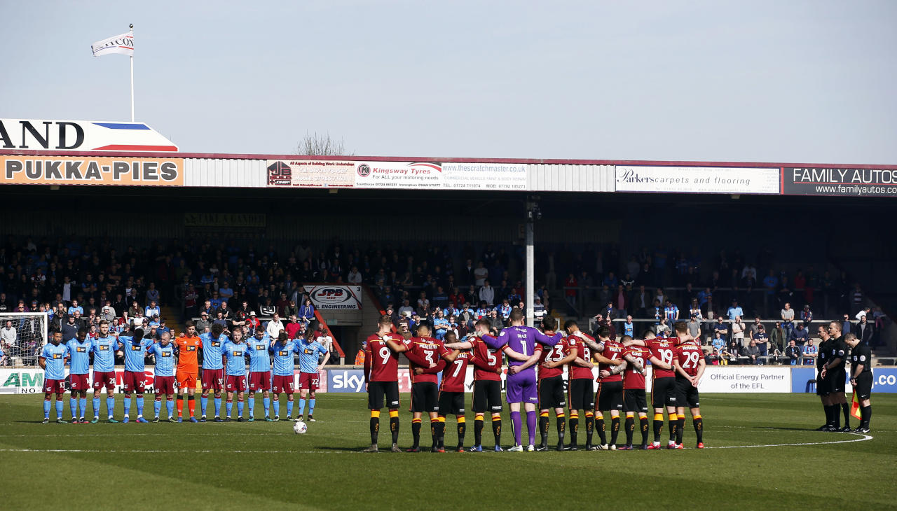 "Britain Football Soccer - Scunthorpe United v Bradford City - Sky Bet League One - Glanford Park - 26/3/17 General view as a minutes silence is observed in respect for the victims of the London attack before the game Action Images via Reuters / Craig Brough Livepic EDITORIAL USE ONLY. No use with unauthorized audio, video, data, fixture lists, club/league logos or ""live"" services. Online in-match use limited to 45 images, no video emulation. No use in betting, games or single club/league/player publications.  Please contact your account representative for further details."