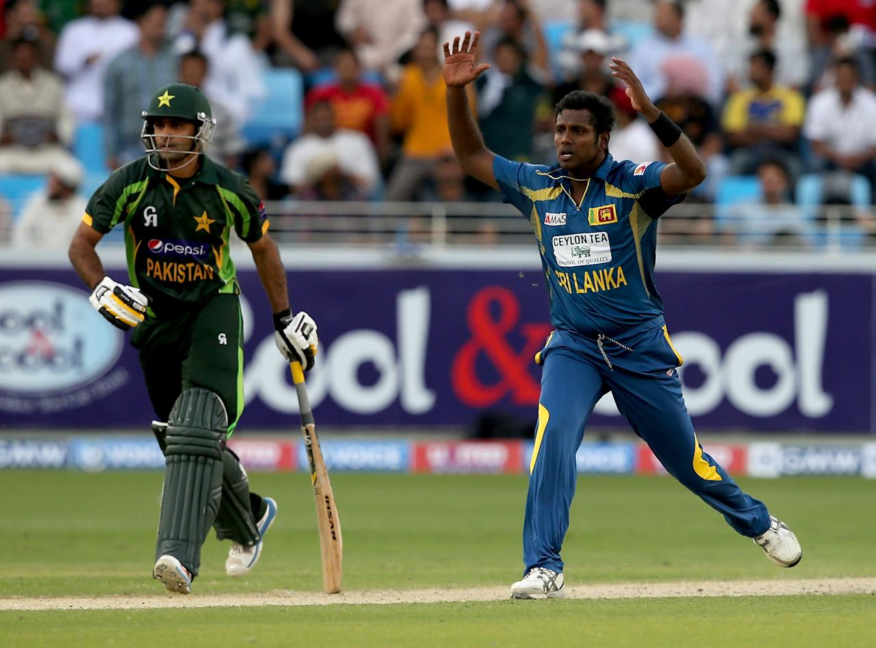 DUBAI, UNITED ARAB EMIRATES - DECEMBER 20:  Angelo Mathews of Sri Lanka reacts during the second One-Day International (ODI ) match between Sri Lanka and Pakistan at the Dubai Sports City Cricket Stadium on December 20, 2013 in Dubai, United Arab Emirates.  (Photo by Francois Nel/Getty Images)