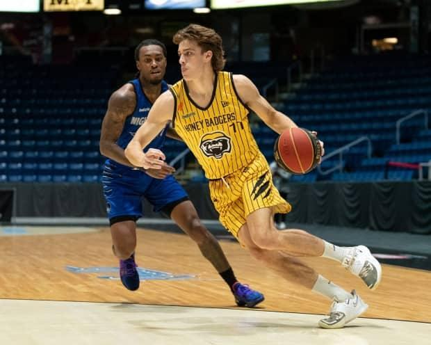 Keevan Veinot of the Hamilton Honey Badgers, ahead,posted a career-high 21 points against the Guelph Nighthawks in CEBL action at the FirstOntario Centre on Monday. (Christian Bender/Guelp Nighthawks - image credit)