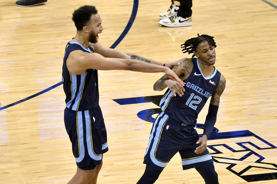Memphis Grizzlies forward Kyle Anderson celebrates with guard Ja Morant (12) after Morant scored the game winning shot against the Miami Heat in the second half of an NBA basketball game Wednesday, March 17, 2021, in Memphis, Tenn. (AP Photo/Brandon Dill)