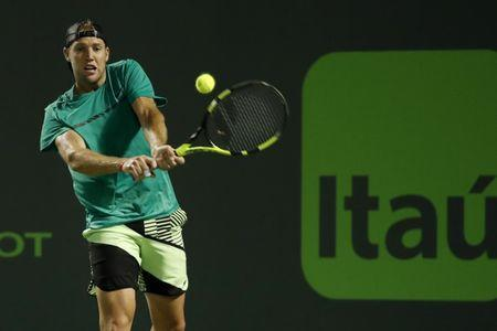 Mar 29, 2017; Miami, FL, USA; Jack Sock of the United States hits a backhand against Rafael Nadal of Spain (not pictured) on day nine of the 2017 Miami Open at Crandon Park Tennis Center. Nadal won 6-2, 6-3. Mandatory Credit: Geoff Burke-USA TODAY Sports