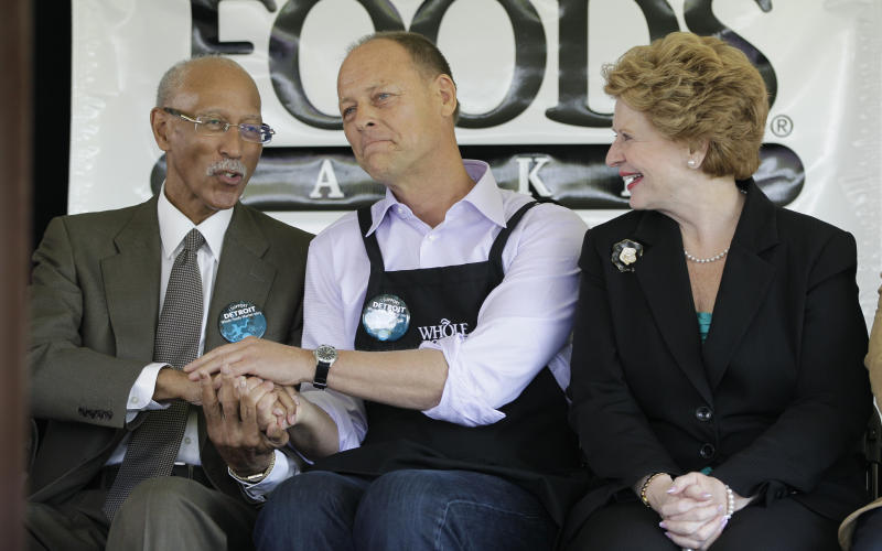 Detroit Mayor Dave Bing, left, and Whole Foods Market co-CEO Walter Robb shake hands as Sen. Debbie Stabenow, D-Mich., watches during a ground breaking ceremony for the retailer in Detroit, Monday, May 14, 2012. The Austin, Texas-based retailer plans to open a 20,000-square-foot supermarket with about 75 employees next year. The company began looking at Midtown in 2010. (AP Photo/Carlos Osorio)