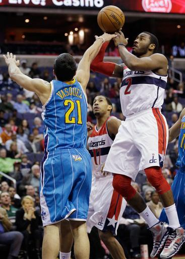 WASHINGTON, DC - MARCH 15: John Wall #2 of the Washington Wizards puts up a shot in front of Greivis Vasquez #21 of the New Orleans Hornets during the second half at Verizon Center on March 15, 2013 in Washington, DC. (Photo by Rob Carr/Getty Images)